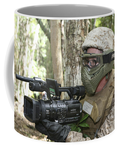 Videotaping Coffee Mug featuring the photograph U.s. Marine Videotapes Combat Exercises by Stocktrek Images