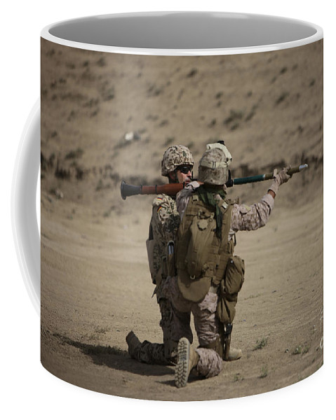 Fragmentation Coffee Mug featuring the photograph U.s. Marines Load A Fragmentation Round by Terry Moore