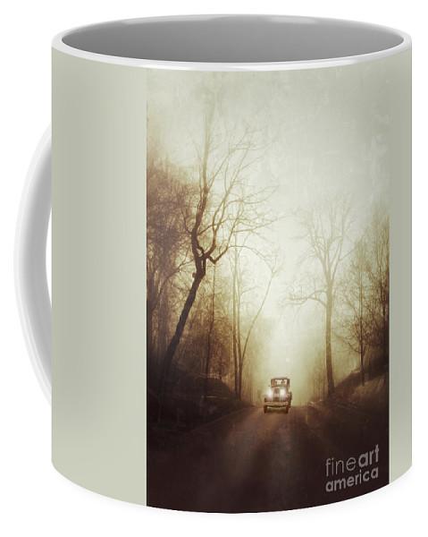 Car Coffee Mug featuring the photograph Vintage Car On Foggy Rural Road by Jill Battaglia