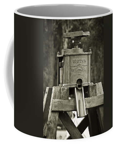 Victor Water Pump Coffee Mug featuring the photograph Vintage Water Pump by Carolyn Marshall