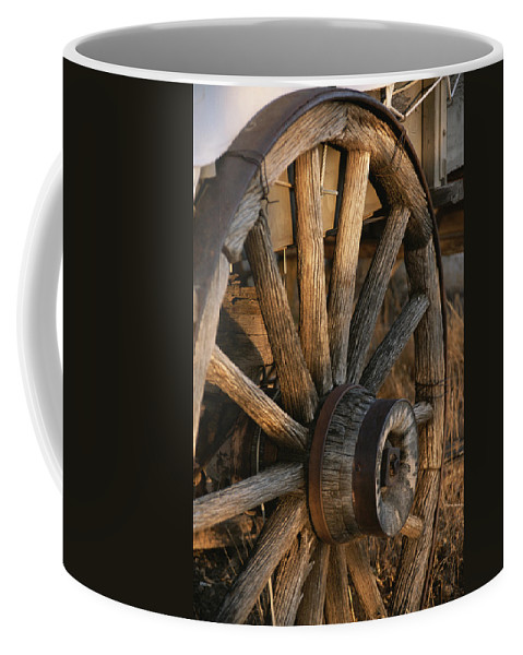 North America Coffee Mug featuring the photograph Wagon Wheel On Covered Wagon At Bar 10 by Todd Gipstein