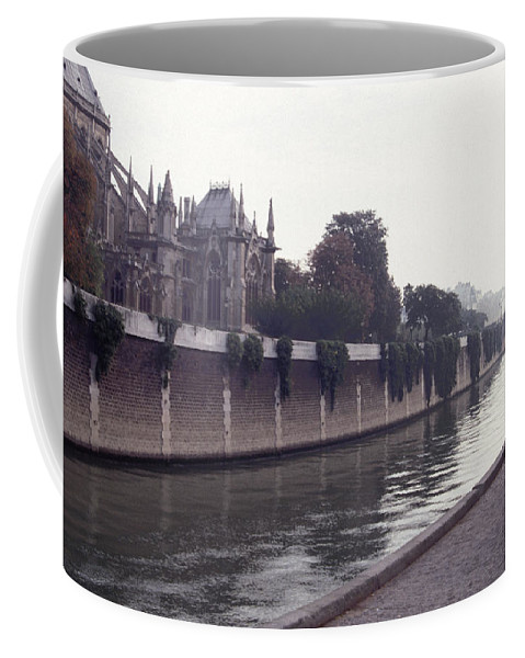 Paris Coffee Mug featuring the photograph Walking The Dog Along The Seine by Tom Wurl