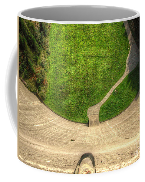 Water Dam Coffee Mug featuring the photograph Water Dam And A Shoe by Mats Silvan