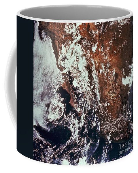 Color Image Coffee Mug featuring the photograph Weather Patterns Over Earth by Stocktrek Images