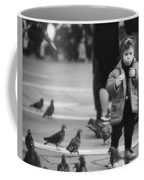 Child Coffee Mug featuring the photograph Whos Feeding Whom by Greg Matchick