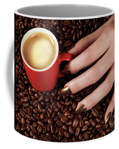 Coffee Coffee Mug featuring the photograph Woman Hand Holding A Cup Of Latte by Oleksiy Maksymenko