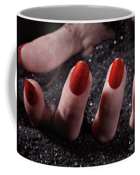 Manicure Coffee Mug featuring the photograph Woman Hand With Red Nail Polish Buried In Black Sand by Oleksiy Maksymenko