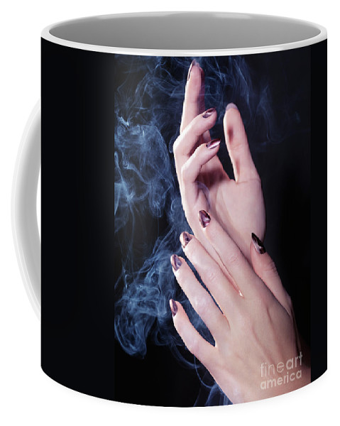 Hands Coffee Mug featuring the photograph Woman Hands In A Cloud Of Smoke by Oleksiy Maksymenko