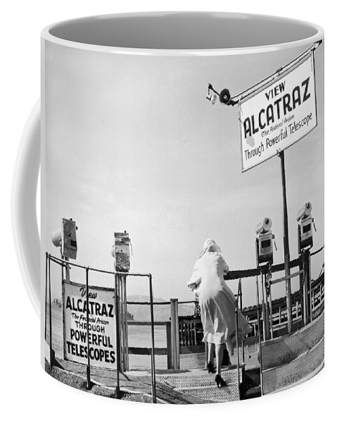 1950's Coffee Mug featuring the photograph Woman Looking At Alcatraz by Underwood Archives
