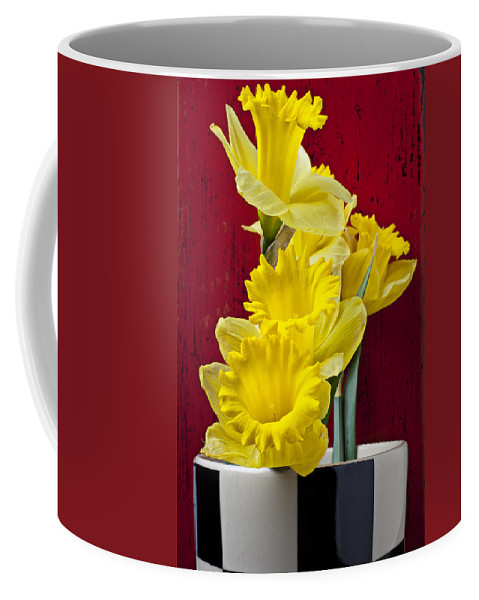 Yellow Coffee Mug featuring the photograph Yellow Daffodils In Checkered Vase by Garry Gay