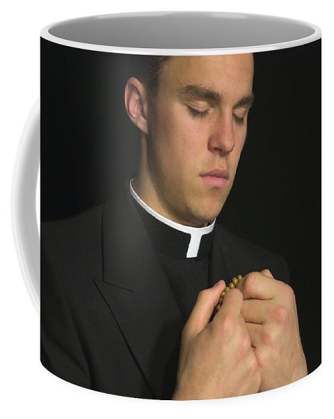 Adult Coffee Mug featuring the photograph Young Priest Praying With Rosery by Gregory Dean