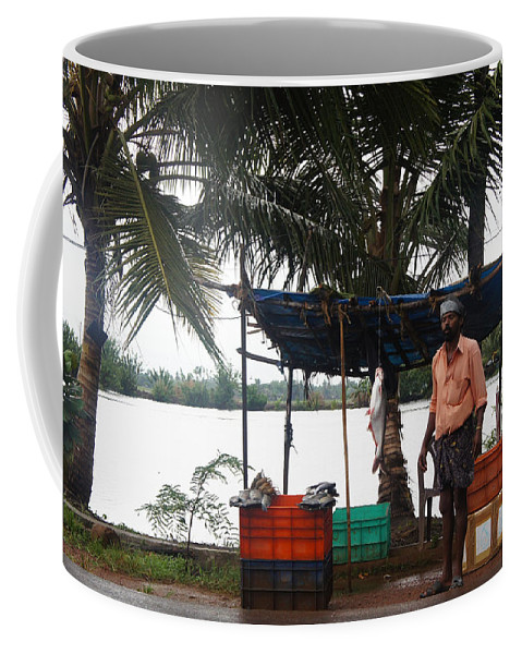 Asian Coffee Mug featuring the photograph Fish Seller by Art Spectrum