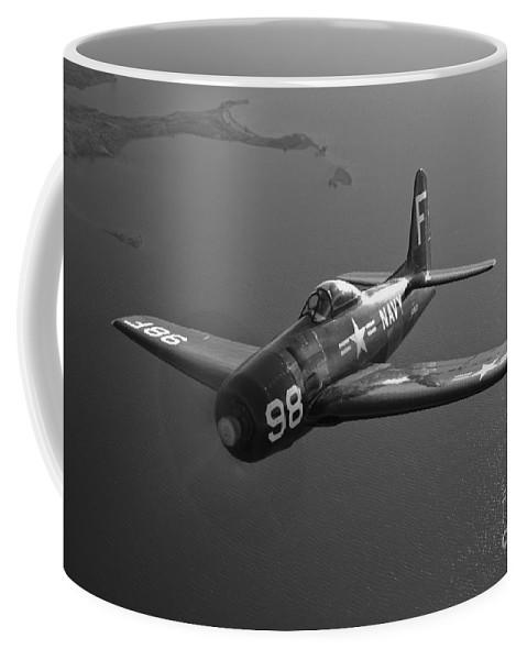 Black And White Coffee Mug featuring the photograph A Grumman F8f Bearcat In Flight by Scott Germain