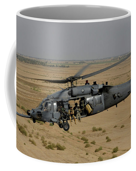 Csar Coffee Mug featuring the photograph A U.s. Air Force Hh-60 Pavehawk Flies by Stocktrek Images