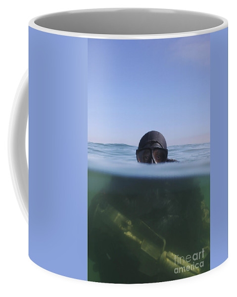 Navy Coffee Mug featuring the photograph A U.s. Navy Seal Combat Swimmer by Michael Wood