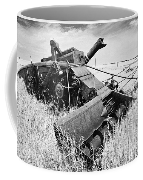 Combine Coffee Mug featuring the photograph Abondoned Combine In Tall Grass by Donald Erickson