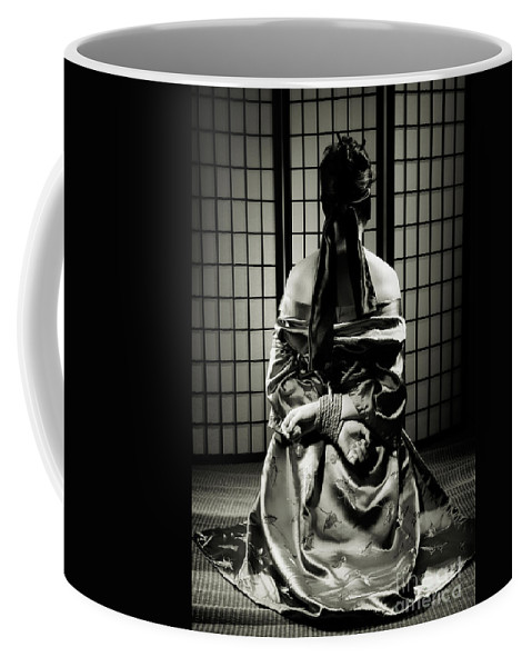 Bondage Coffee Mug featuring the photograph Asian Woman With Her Hands Tied Behind Her Back by Oleksiy Maksymenko