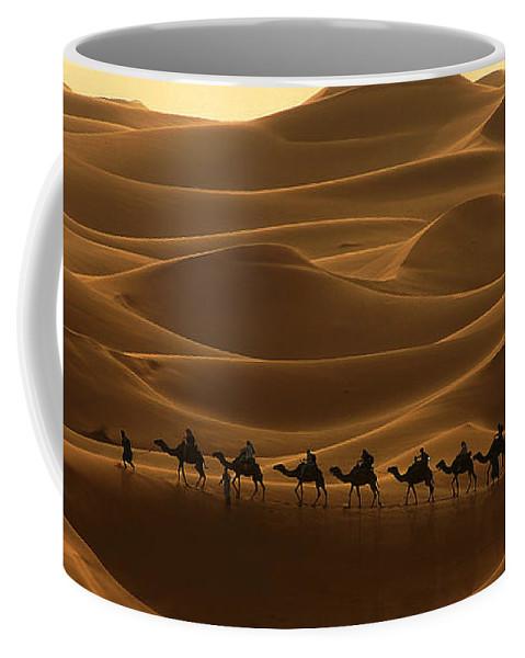 Camel Coffee Mug featuring the photograph Camel Caravan In The Erg Chebbi Southern Morocco by Ralph A Ledergerber-Photography
