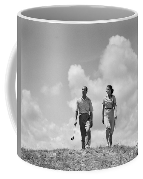 1930s Coffee Mug featuring the photograph Couple Out Golfing, C.1930s by H. Armstrong Roberts/ClassicStock