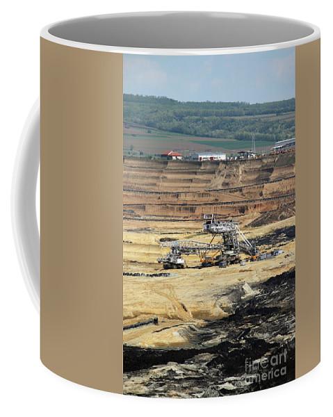 Coal Coffee Mug featuring the photograph Excavators Working On Open Pit Coal Mine by Goce Risteski