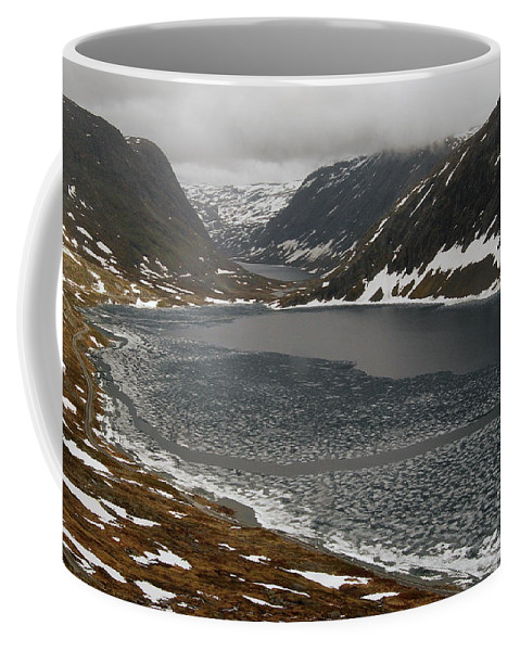 Norway Coffee Mug featuring the photograph Mt. Dalsnibba And The Serpentine Descent To The Geirangerfjord by Harvey Barrison