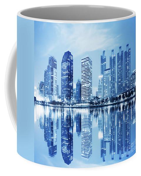 Architecture Coffee Mug featuring the photograph Night Scenes Of City by Setsiri Silapasuwanchai