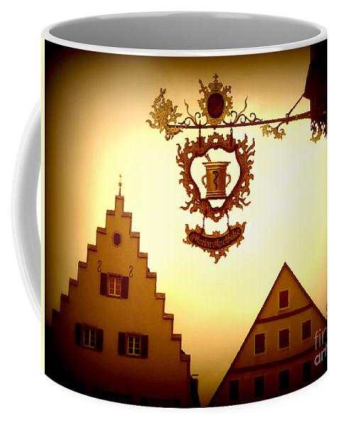 Rothenburg Coffee Mug featuring the photograph Pharmacy Sign In Rothenburg by Carol Groenen