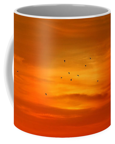 Silhouettes Coffee Mug featuring the photograph Upon A Sunset Flight by Angie Tirado