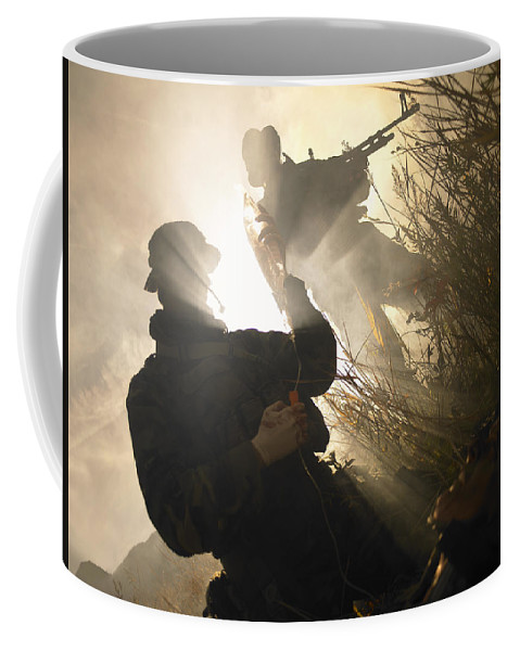 Special Operations Forces Coffee Mug featuring the photograph U.s. Navy Seals Give First Aid by Tom Weber