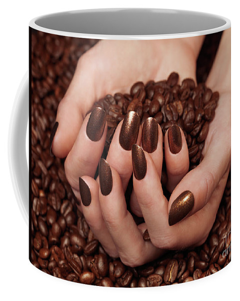 Coffee Coffee Mug featuring the photograph Woman Holding Coffee Beans In Her Hands by Oleksiy Maksymenko