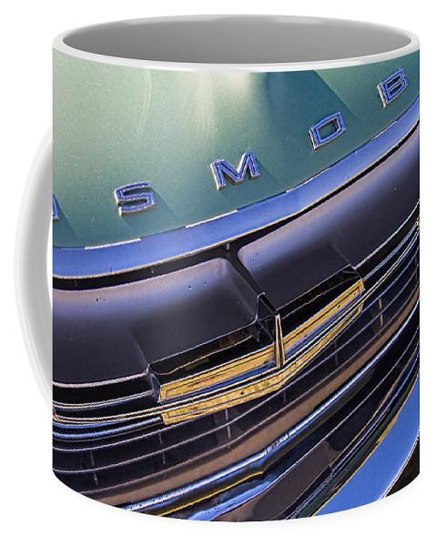 1964 Coffee Mug featuring the photograph 1964 Oldsmobile Jetstar Hood Ornament by Nick Gray