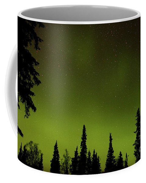 Aurora Coffee Mug featuring the photograph Northern Glow by Rick Monyahan