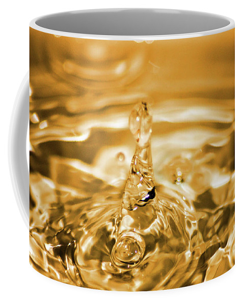 Water Coffee Mug featuring the photograph Splash by Ilaria Andreucci