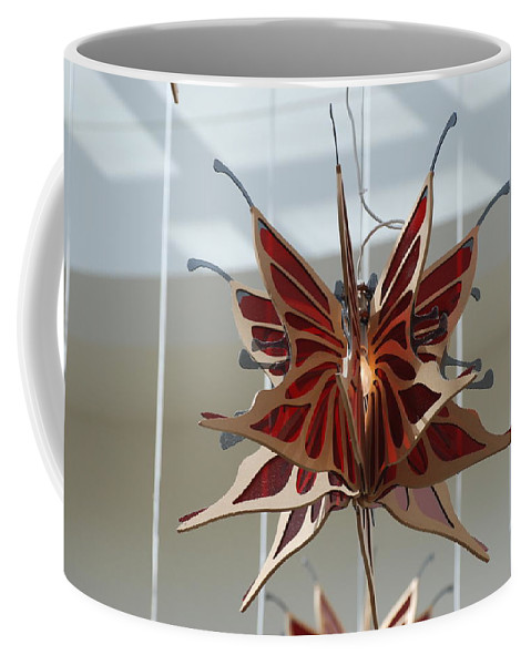 Architecture Coffee Mug featuring the photograph Hanging Butterfly by Rob Hans