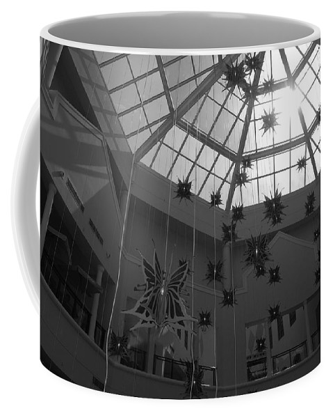 Black And White Coffee Mug featuring the photograph Hanging Butterflies by Rob Hans
