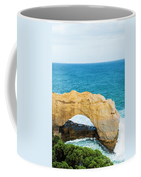 Arch Coffee Mug featuring the photograph The Arch At Port Campbell National Park by Rob D