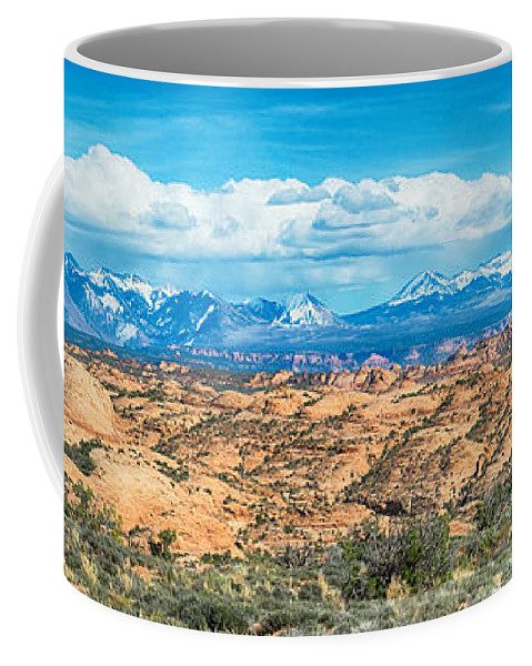 Snow Coffee Mug featuring the photograph Canyon Badlands And Colorado Rockies Lanadscape by Alex Grichenko