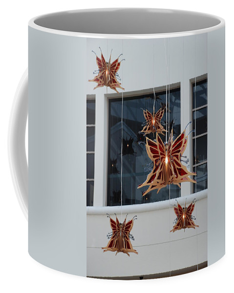 Architecture Coffee Mug featuring the photograph Hanging Butterflies by Rob Hans