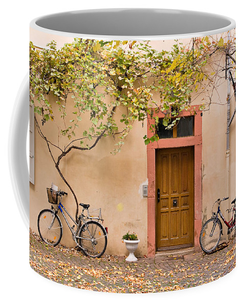 Travel Coffee Mug featuring the photograph A Back Lane In Speyer by Louise Heusinkveld