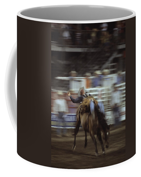 Steamboat Coffee Mug featuring the photograph A Cowboy Rides A Bucking Bronco by Taylor S. Kennedy