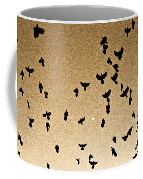 Flock Coffee Mug featuring the photograph A Flight Of Grackles Circling The Moon by John Harmon