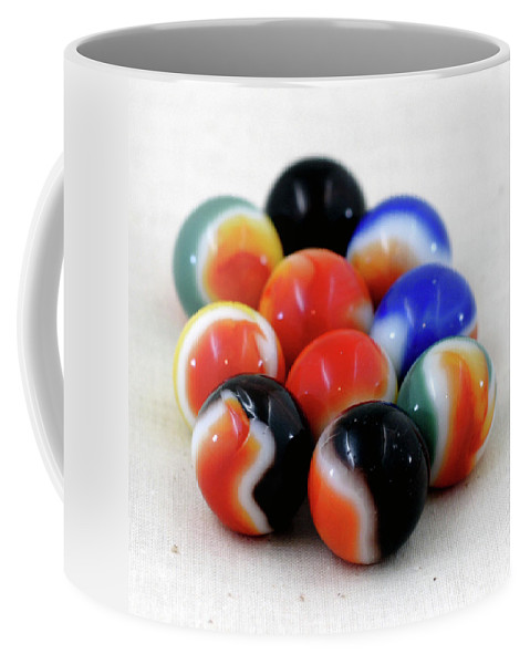 Antique Coffee Mug featuring the photograph A Fun Game Of Marbles by Alan Look