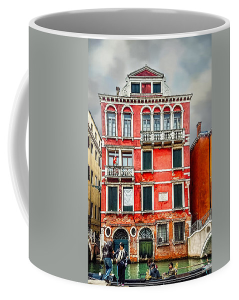 City Coffee Mug featuring the photograph A Helping Hand by Maria Coulson