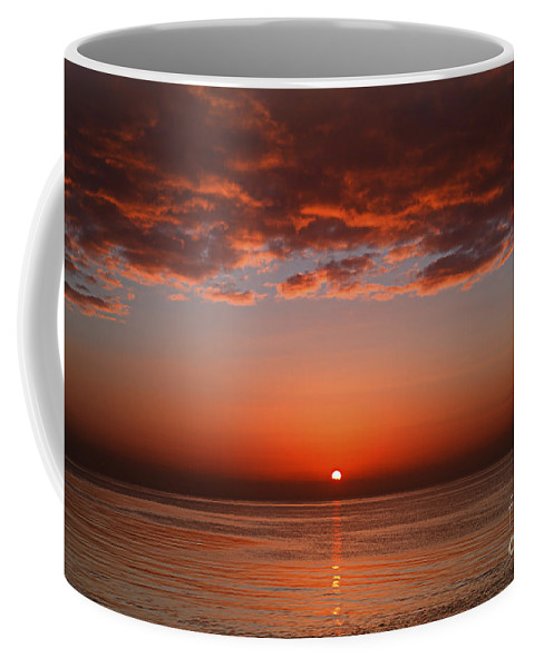 Scenic Coffee Mug featuring the photograph A Layer Of Clouds Is Lit By The Rising by Luis Argerich