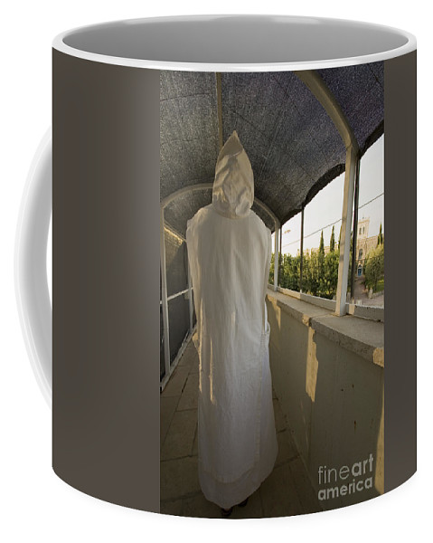 Nun Coffee Mug featuring the photograph A Nun In A Monastery by Danny Yanai