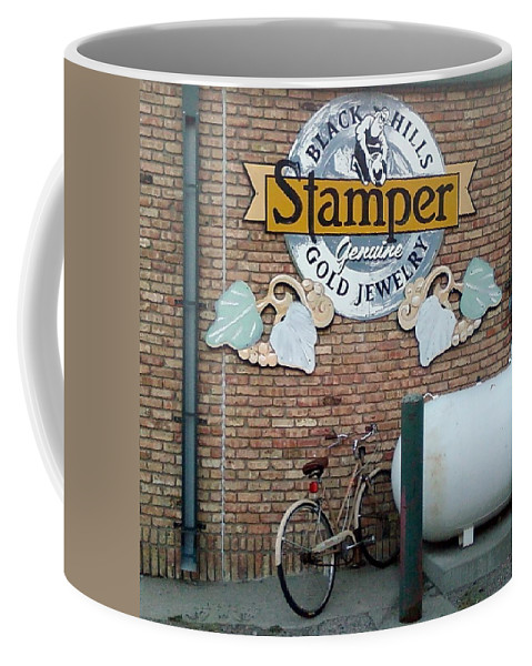 Bicycle Sign Rain Gutter Bricks Coffee Mug featuring the photograph A Parked Bicycle by Cindy New