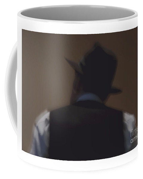 Portrait Coffee Mug featuring the photograph A Portrait Of A Man In A Black Hat. by Alexander Vinogradov