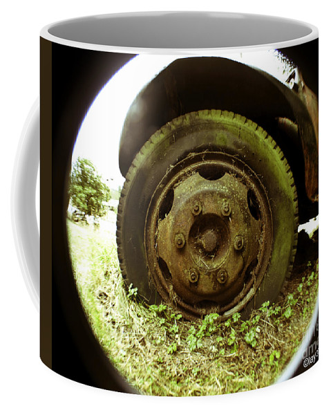 Art Coffee Mug featuring the photograph A Rolling Tire Gathers No Moss by Clayton Bruster