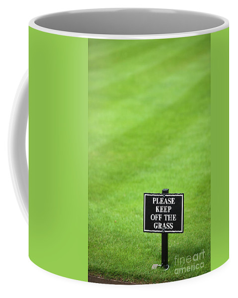 Keep Off The Grass Coffee Mug featuring the photograph A Sign In The Lawn Reading Keep Off The Grass by Lee Avison
