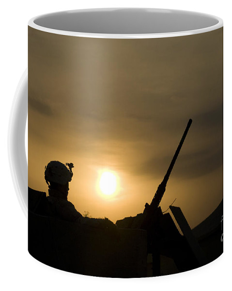 Camp Warhorse Coffee Mug featuring the photograph A Us Soldier Mans His .50 Caliber While by Terry Moore